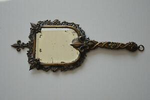 Ancien miroir face à main en bronze XIXe verre biseauté Fleur de Lys