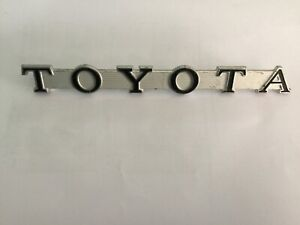 A Toyopet Toyota Crown RS40 Badge Emblem, new old stock