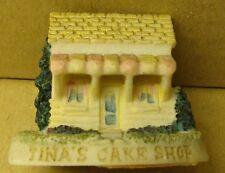 Vintage resin/ceramic look ornament of Tina's cake shop.