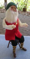Byers Choice Seated Santa on Chair with Magnifying Glass Striped Socks Mint