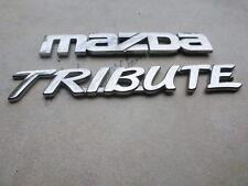 04-10 Mazda Tribute Tailgate EC01 51 711 Logo EC01 51 721 B Emblem Decals Set
