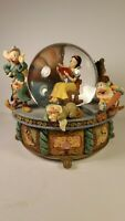 SNOW WHITE ROCKING SNOWGLOBE WITH SEVEN DWARFS. ANIMATED AND MUSICAL. EXC. COND!