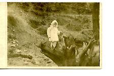 Cute Little Girl-Fur Winter Coat-Cap-Tree Trunk-RPPC-Real Photo Vintage Postcard