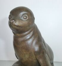 """Baby Seal Perched on a Rock, Ceramic Sculpture 7-1/2"""" Tall"""