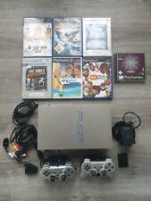 PlayStation 2 fat in silber mit 2 Controllern, 7 Spielen und Eye Toy Kamera