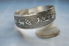 Beautiful tibetan silver bangle bracelet with various animals engraved