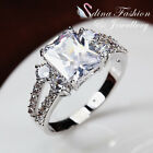 18K White Gold Plated Simulated Diamond Split Band Side Stones Emerald Cut Ring
