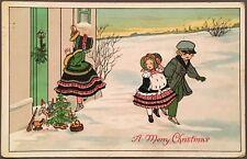 Christmas ~ Boy & Girl Walk By Girl Knocking On Door Near Presents & Tree