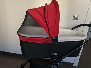 Capazo Baby Jogger Deluxe, color rojo. Estado impecable, solo tiene 6 meses.