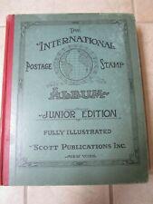 THE INTERNATIONAL POSTAGE STAMP ALBUM JUNIOR EDITION ILLUSTRATED + STAMPS