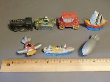 Lot Of 7 Painted Bisque Transportation Figurines Tank Plane Ship Train Sail