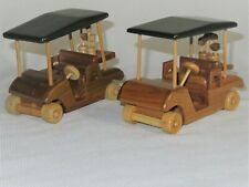 2 Hand-Carved Wooden Model Golf Carts with dark green Sun Canopies