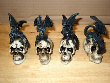 Dragon On A Skull Figurine Set ( Set Of 4 )