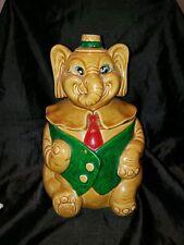 VINTAGE COOKIE JAR ELEPHANT WITH GREEN VEST( BINGO?)