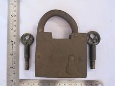 An old iron trick or puzzle padlock lock with 2 screw type key