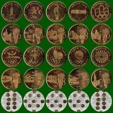 10 MEDALLAS CONMEMORATIVAS JUEGOS OLÍMPICOS DE 1964 A 2000. BAÑO ORO 22 Kilates