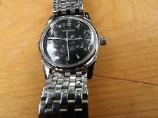 Men's hand winding 17 jewel Benrus watch with stainless deployment band