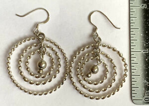925 Sterling Silver Woman's Dangling Earrings Excellent Condition.
