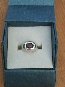 Beautiful Sterling Silver 925 Ring with red stone in the centre.