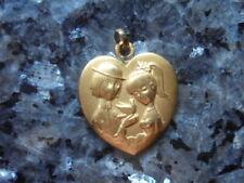 belle  medaille en forme de coeur des amoureux de peynet .....