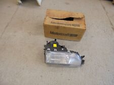 ford .SAPPHIRE. LHD.....NEW GENUINE ....O/S/F HEAD LIGHT