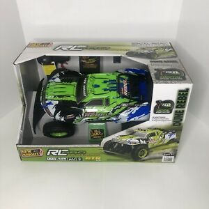 New Bright RC Pro 1:12 Scale Radio Controlled Car  Dune Rebel 2.4GHz 9.6V - RTR