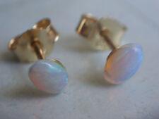 Kristall Opal Ohrstecker Gold 333, schöne Ohrstecker Gold 333 mit Opal 6 x 4 mm