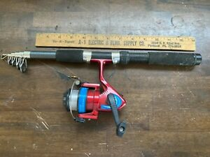 TELESCOPING SPINNING ROD WITH REEL