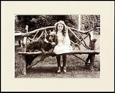 FLAT COATED RETRIEVER DOG AND GIRL ON RUSTIC SEAT PRINT MOUNTED READY TO FRAME