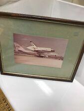 photo of nasa space ship on plane