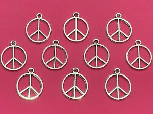 Tibetan Silver Peace Symbol Charms - pack of 10