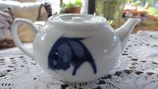 Chinese White Teapot with Blue Fish