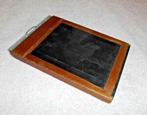 Vintage Folmer Graflex 5 x 7 Wood Cut Film Holder with film in it.