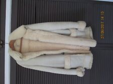 Sheepskin coat with deer horn buttons