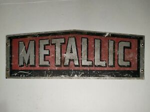 "Vintage ""Metallic"" Metal wall sign used"
