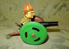 Vintage Clockwork Tin Toy Fireman On A Water Cannon
