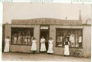 SOCIAL HISTORY POSTCARD TIN TOWN ? TAYLOR'S STORES POSSIBLY ELY REAL PHOTO C1910