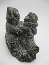 The Wolf Sculptures Inuit Lovers Couple Meeting in Kayaks Soapstone Sculpture