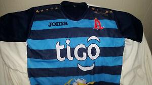 CAMISA ALIANZA FC RAYADA CELESTE CON AZUL - EL SALVADOR