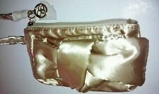 """Jessica Simpson small gold tone polyester w/ bow in front & 6"""" strap wristlet"""