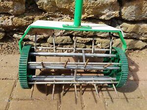 Tudor brand Wheeled Lawn Spiker