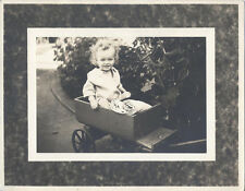 ORIGINAL VINTAGE PHOTOGRAPH OF SMILING CHILD IN WAGON OUTDOORS