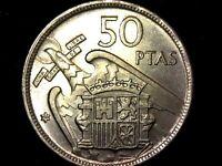 50 pesetas 1957 estrella 59 media pluma ala izquierda (A7)