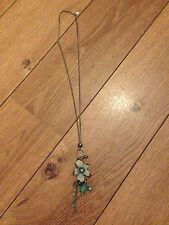 Accessorize Necklace with Beaded Flower Pendant