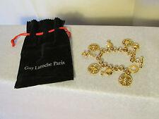 bracelet breloques vintage GUY LAROCHE  métal doré