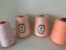 Bundle On Pink, Peach And Orange Yarn Cones