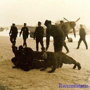 **RARE! Luftwaffe Jagdstaffel Airmen Playing in Winter by Me-109 Fighter Plane**