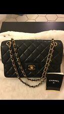 100% Authentic Chanel Vintage Logo Lambskin Double Face Shoulder Bag.