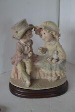 Giuseppe Armani  ? Young Boy and Girl Serving Tea on Bench Capodimonte Figurine