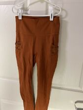 fabletics leggings xs, great condition! Burnt Orange With Side Pockets
